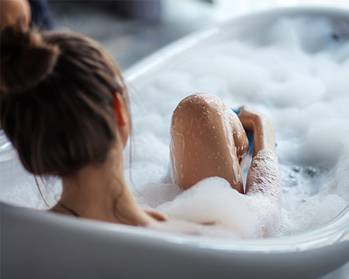 woman in repaired bathrub